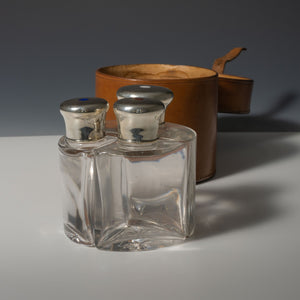 Leather Cased Silver and Enamel Top Bottles