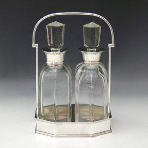 Pair of Cut Glass Silver Collared Decanters