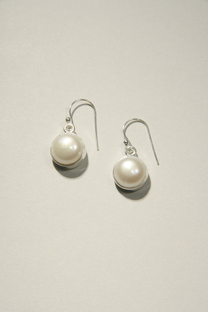Sterling Silver Classic Pearl Dangles, $24 | Light Years Jewelry