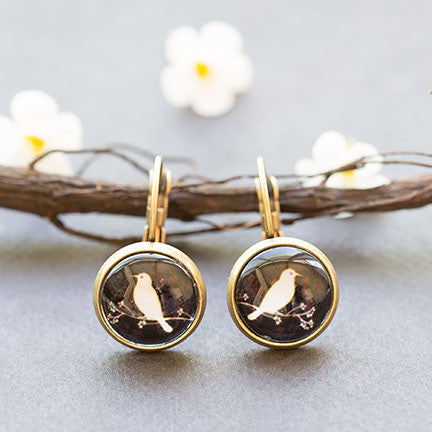 Beijo Brasil Bird Silhouette Glass Dome Dangles, $14 | Brass Earrings