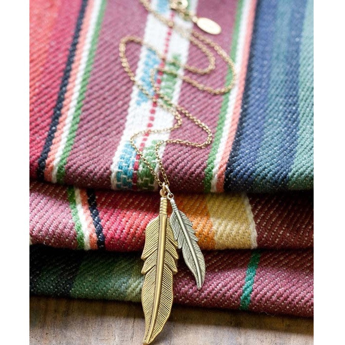 Amano Mixed Metal Feather Necklace, $26 | Sterling Silver | Light Years