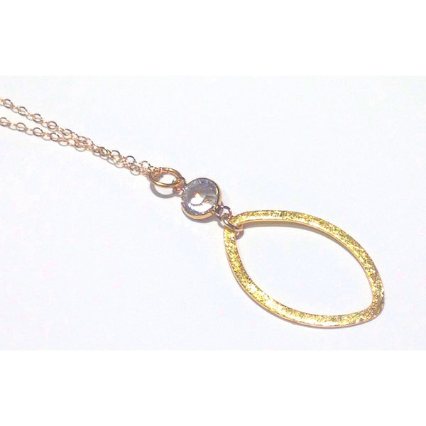 Brushed Oval and Clear Crystal Necklace, $34 | 14kt Gold | Light Years
