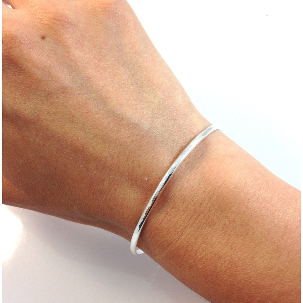 Slender Hammered Cuff Bracelet, $24 | Gold and Silver | Light Years