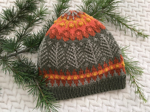 Colorwork hat knit in sage green, grey, orange, pink, and yellow