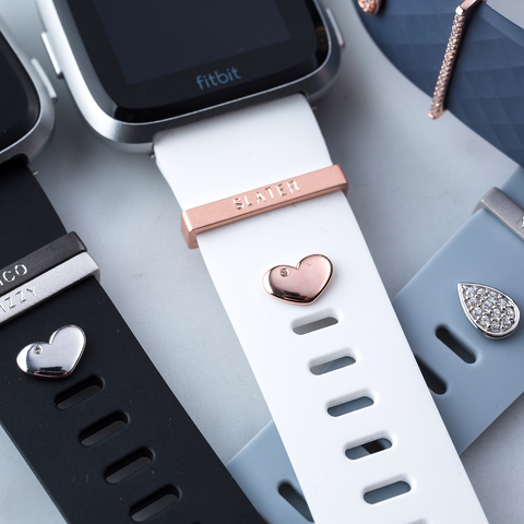 Pictured here: heart studs in silver and rose gold with a teardrop stud in silver for Fitbit Versa