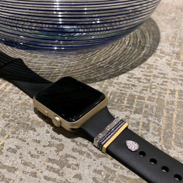 Bytten Africa Stack on gold Apple Watch with black sport band