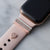 Gold Apple Watch with pink Sport band and rose gold glam stack with engraved gold 3mm ring