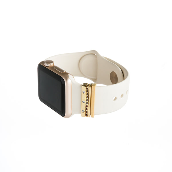 gold Apple Watch with white Sport band and bytten Monaco Stack accessory - gold