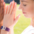 Woman in yoga pose wearing Fitbit Charge with Bytten OM slide - sterling silver
