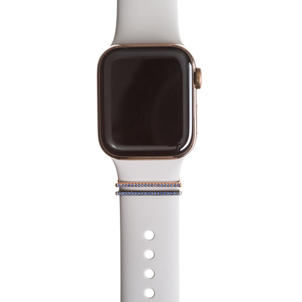 Gold Series 4 Apple Watch with white Sport band and tiny tanzanite crystal rings
