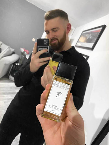 man holding an aftershave bottle