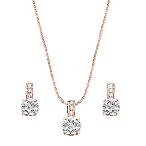 Adjustable necklace with clear crystals on a rose gold finish, with matching earrings, earrings measure 1cm.