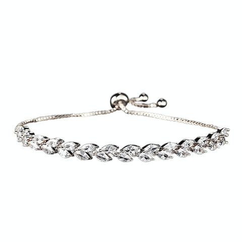 Fully adjustable crystal bracelet on a rhodium plated finish with clear crystals.