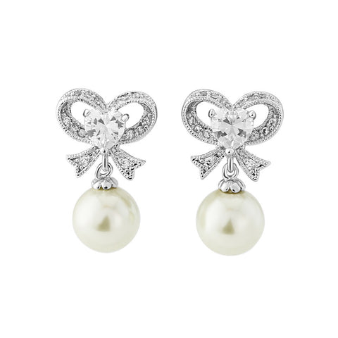 Clear crystal and Ivory pearl earrings in a unique bow style with a drop of 3cm