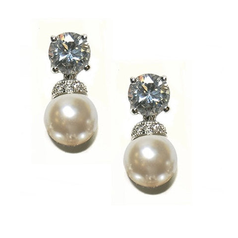 Crystal and pearl earrings made from high quality cubic zirconia clear crystals with ivory pearls on a rhodium plated finish, earrings measure 2.2cm.