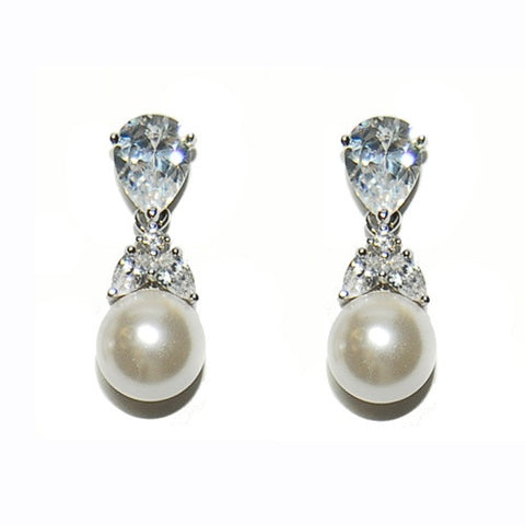 Crystal and pearl earrings made with high quality cubic zirconia clear crystals and ivory pearls on a rhodium plated finish, earrings measure 2.3cm.
