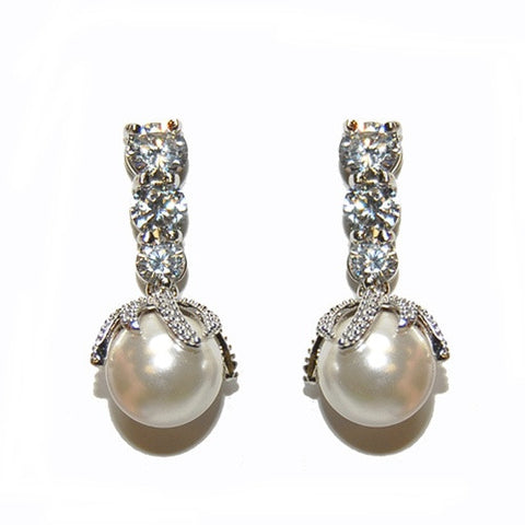 Crystal and pearl earrings made from high quality clear cubic zirconia crystals and ivory pearls on a rhodium plated finish, they have a drop of 3cm