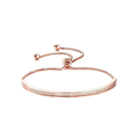 Adjustable crystal bracelet made with clear crystals on a rhodium plated rose gold tone finish, width 0.5cm.