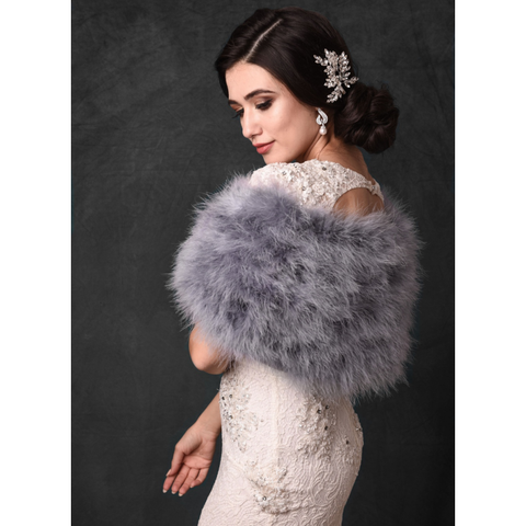 Side view of bride wearing a silver grey marabou feather stole wrap
