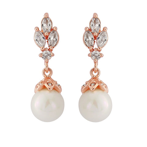Crystal and pearl drop earrings made with clear cubic zirconia crystals and simulated ivory pearls on a rhodium plated rose gold finish, they measure 3cm long