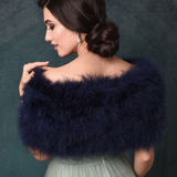 Back view of bride wearing a Navy Blue marabou feather stole wrap acroos her shoulders
