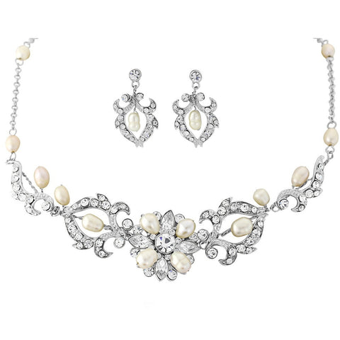 Crystal and pearl necklace and earrings set made with Swarovski crystals and freshwater ivory pearls plated in real silver, necklace is adjustable and the earrings measure 2.5cm