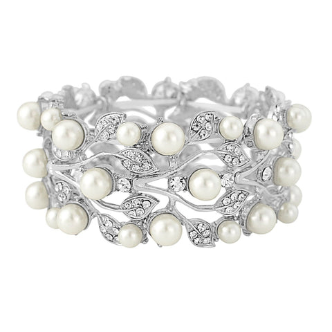 Stunning bracelet made with luxurious clear crystals and ivory pearls on a silver tone finish.