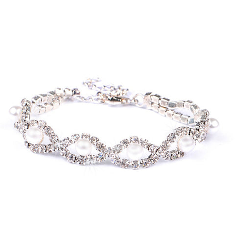 Lobster clasp bracelet made with cubic zirconia clear crystals and simulated ivory pearls, width 1cm.
