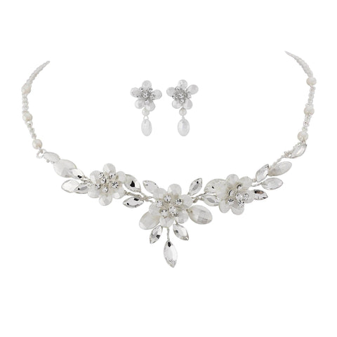 Crystal and pearl necklace and earrings set made with frosted Swarovski crystals and ivory pearls on a high quality silver plated finish, the necklace is adjustable and the earrings have a drop of 1.5cm