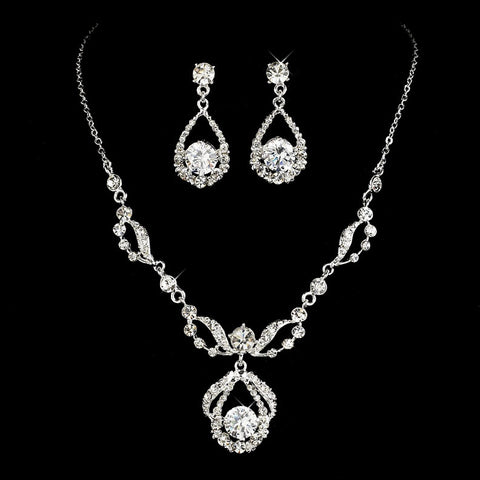 Crystal necklace and matching earrings set made from clear crystals on a silver tone finish, the necklace is fully adjustable and the earrings measure 3.5cm long.