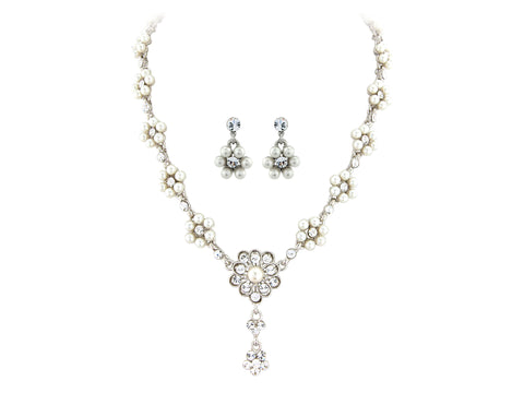 Crystal and pearl necklace set made from clear Swarovski and cubic zirconia crystals on a silver tone finish, the necklace is fully adjustable and the earrings measure 2cm long.
