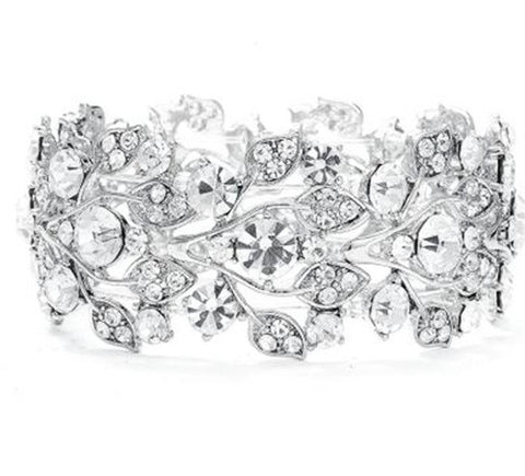 Elasticated crystal flower bracelet made with clear crystals on a silver tone finish.