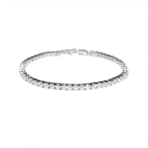 Petite and chic crystal bracelet made with clear cubic zirconia crystals on a silver tone rhodium plated finish.