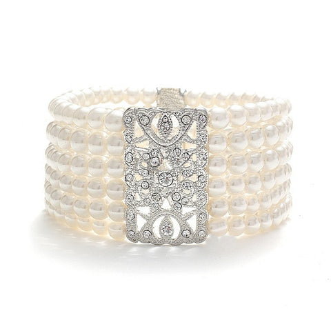 Elasticated pearl bracelet with six rows of simulated ivory pearls and a unique crystal embellishment, bracelet measures 4cm.