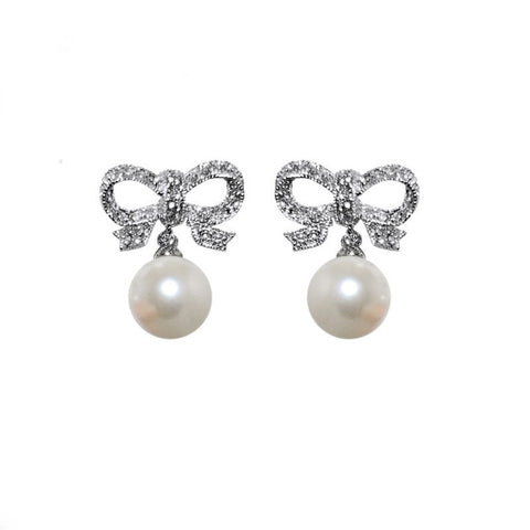 Crystal and pearl earrings in a elegant bow design, earrings have a drop of 2cm.
