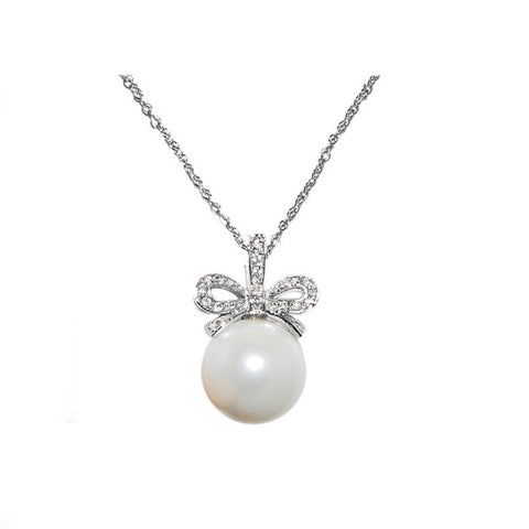 Bow necklace with high quality crystals on a rhodium plated finish, the 2cm bow pendant is finished with a ivory pearl.