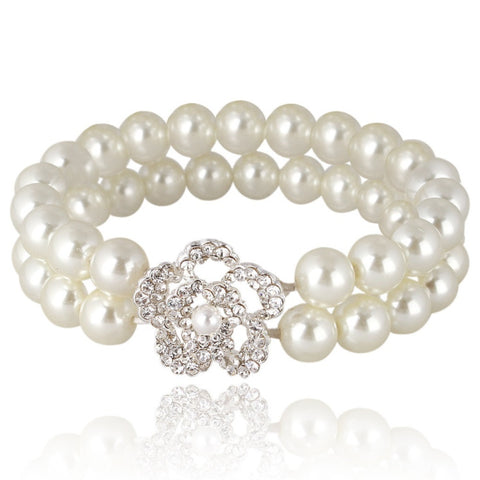 Elasticated pearl bracelet with a double row of pearls and a elegant clear crystal embellished flower.