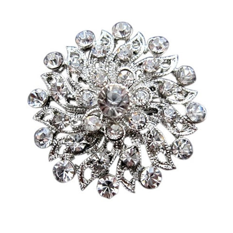 Crystal brooch made with clear crystals on a silver tone finish, brooch measures 3.2cm by 3.2cm