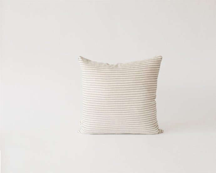 Capital lines linen cushion pillow by oat studio photographed in a white studio by Jenny Wu.