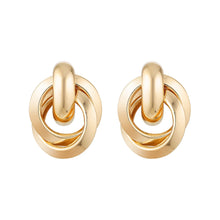 Load image into Gallery viewer, Product image of gold rounded earrings by Trove.