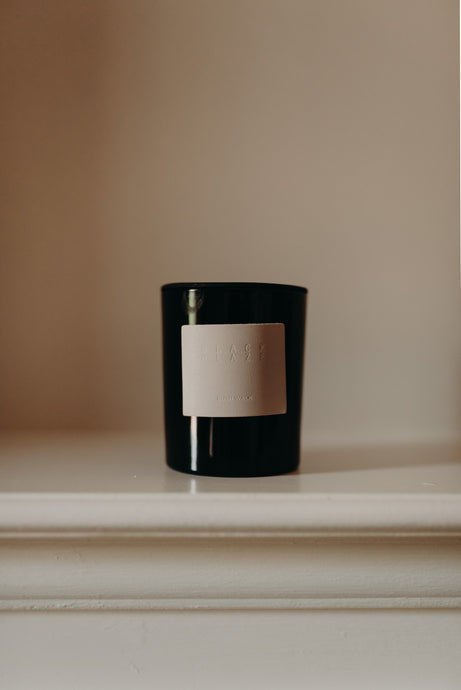 Black Blaze bush walk scented candle. Product image for unparalleled.studio