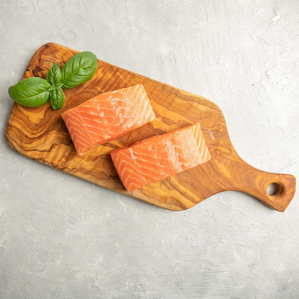 Antarctic Salmon Fillet on Cutting board by FishFinery