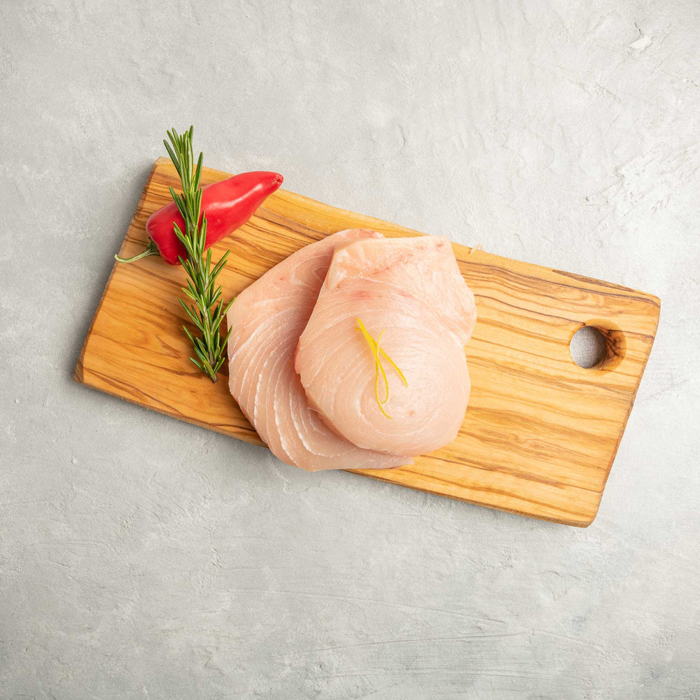Swordfish Steak garnished on cutting board by FishFinery