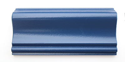 A piece of trim painted blue using a satin paint.