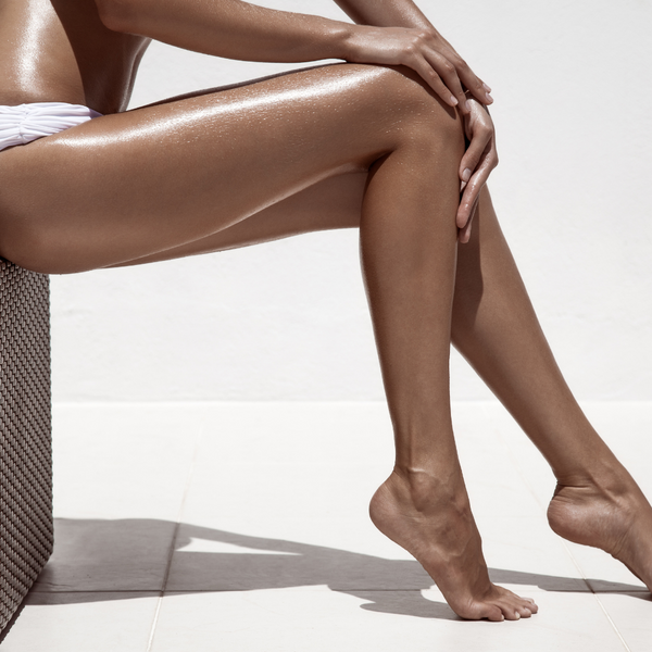 Preparing for your spray tan to achieve a flawless golden glow.