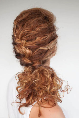 French braided low ponytail. Image source: The Under Cut