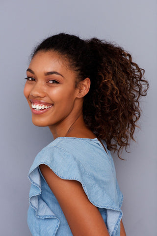 High relaxed ponytail hairstyle for curly hair