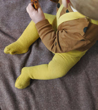 Load image into Gallery viewer, Baby wearing mustard baby tights sat eating pizza on floor