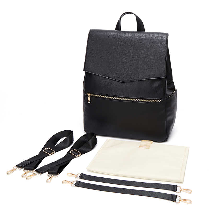 Black backpack changing bag and extra straps and free changing mat