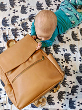 Load image into Gallery viewer, Baby lying on tummy next to tan backpack changing bag